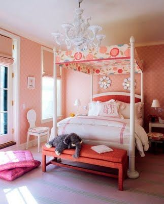 A girls bedroom with a lively canopy and monogrammed bedding, personalizing the space.