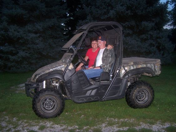 My wife and getting ready to take an evening ride in my Yamaha 700 fuel injected Rhino 4x4