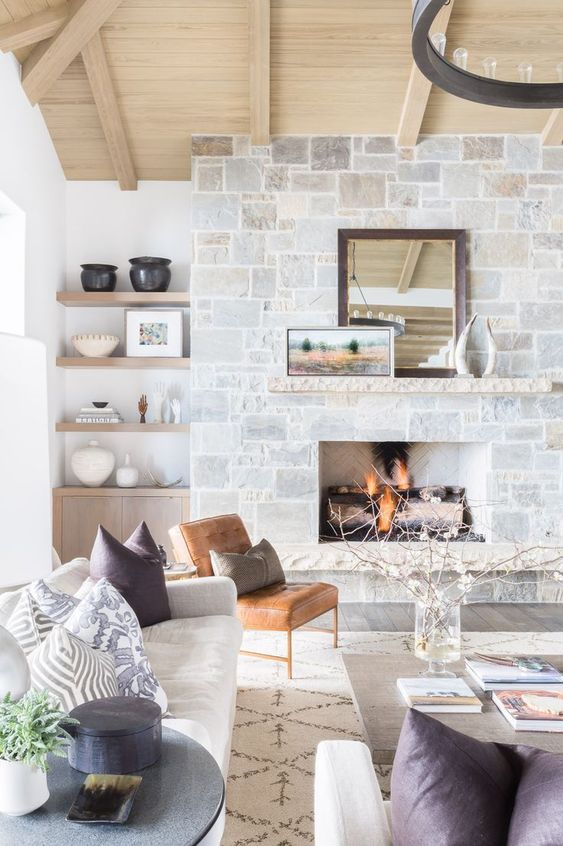Stone fireplace + open shelves + modern furniture   Nicole Davis Interiors