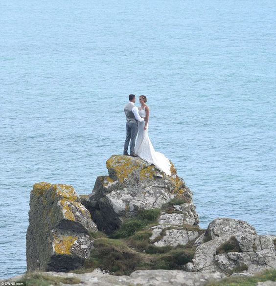 Love on the rocks: The couple gazed adoringly at one another while precariously perched on a jutting crop of rocks: