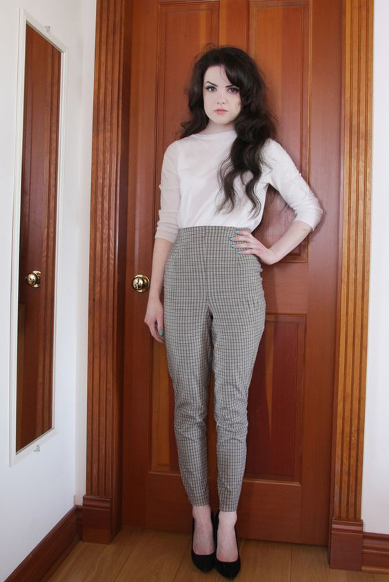 High waisted patterned trousers, white long sleeved top, black heels