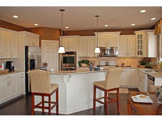 white cabinets with medium hardwoods