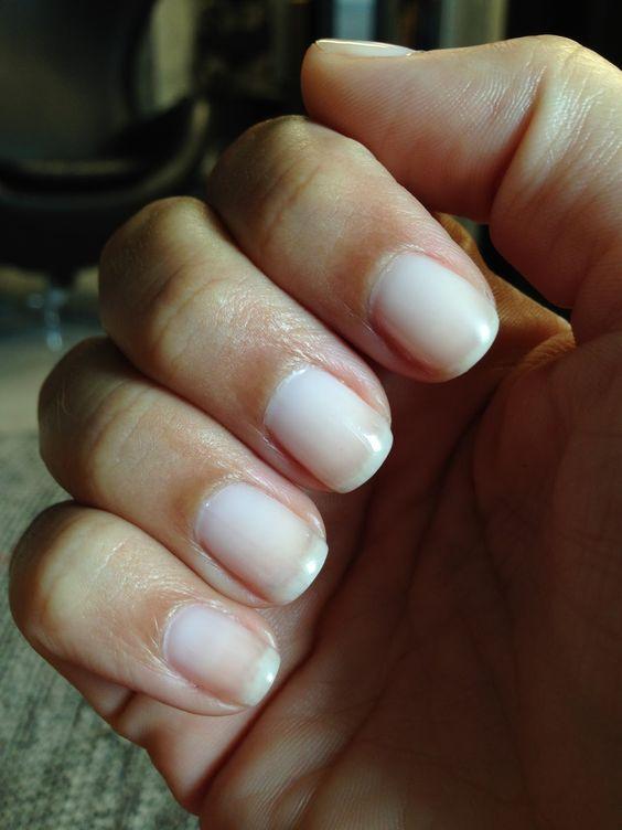 Applying french manicure gel