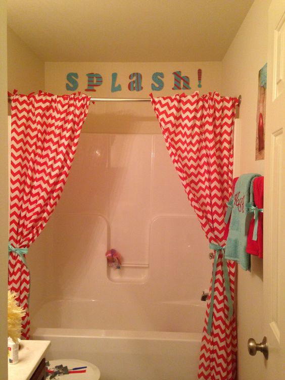 Red and blue bathroom with chevron shower curtains love it