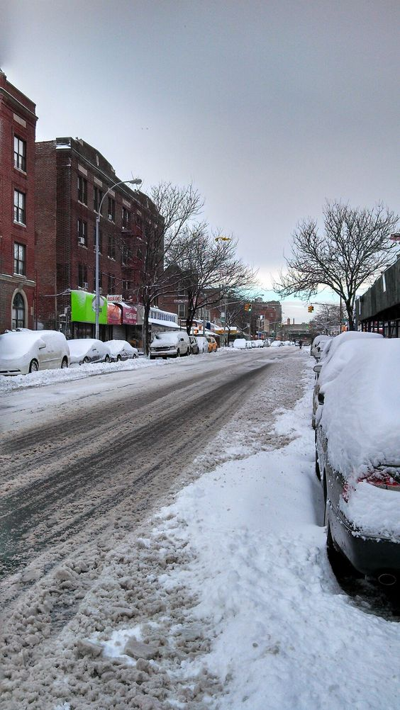 Not too much snow in Brooklyn. Blue sky at the end of the road.