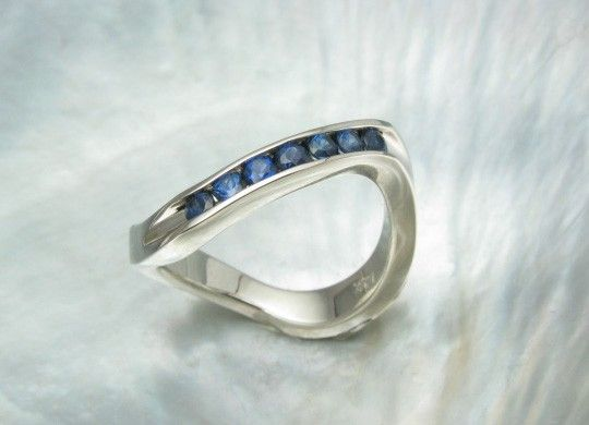 blue sapphire ring - half eternity band - wavy stacking ring -- channel setting in 14k white gold. $584.00, via Etsy.