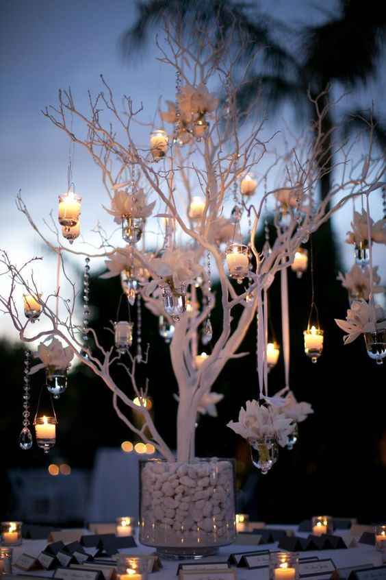 Oversized manzanita branches in cylinders for accent pieces. Use led candles from branches. Remove all hanging flowers and crystals. Keep branches natural brown tone.