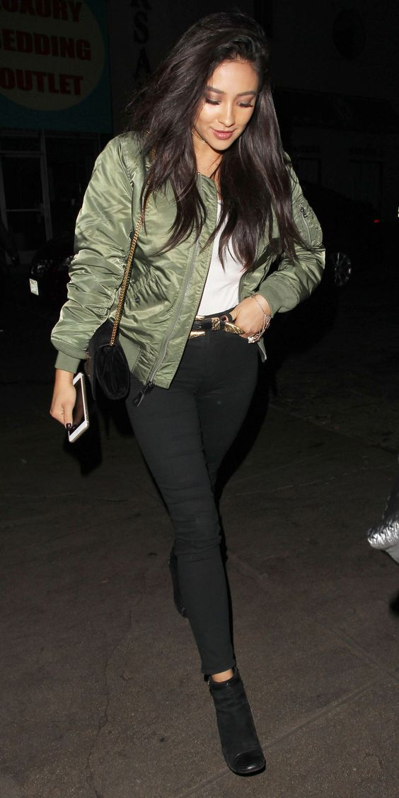 Shay Mitchell elevated her white tee and black high-waist skinnies with her sleek bomber.