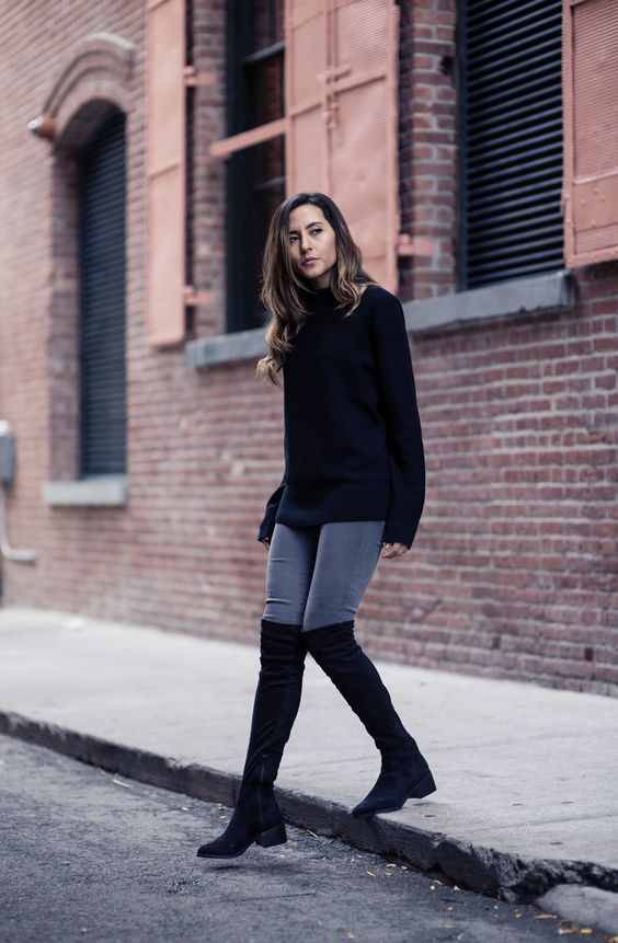 Raquel Paiva wears a pair of over the knee boots with a simplistic black knit sweater and grey skinny jeans. Boots: Call it Spring, Watch: Great George, Sweater: Uniqlo, Jeans: DSTLD.