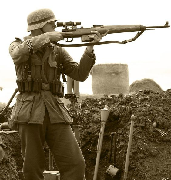 German sniper deploys the Gewehr 43 semi automatic rifle.
