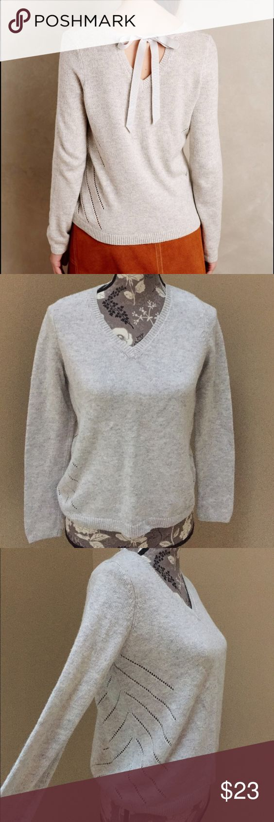 Anthropologie Moth ribbon tie back sweater Anthropologie Moth gray ribbon tie back sweater.  V neck front and back cut out with tie back detail. Super cute and fun. Size small. Excellent condition. Chest is 19 in flat and length is 22 in long. Sleeves measure roughly 25 in. A cotton cashmere blend 53% cotton, 26% viscose, 5% cashmere and 1% spandex. Anthropologie Sweaters