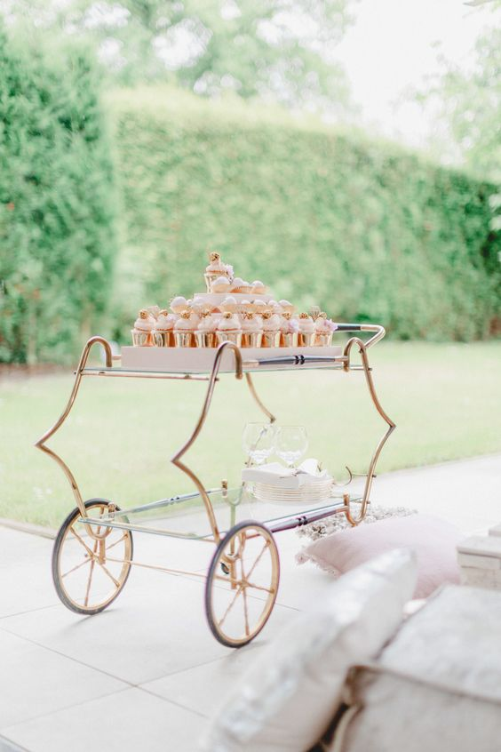 Is there anything more fun than grab-and-go desserts? Staff at this wedding wheeled gold-wrapped cupcakes around to guests on a gilded cart for a little extra luxury.