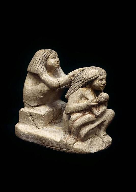 Group of Two Women and a Child, Period: Middle Kingdom–Early New Kingdom, Dynasty: Dynasty 12–18, Date: ca. 1981–1500 B.C. Country of Origin: Egypt, Medium: Limestone, paint, Dimensions: h. 7.2 cm (2 13/16 in); w. 7.5 cm (2 15/16 in) Credit Line: Rogers Fund, 1922 Accession Number: 22.2.35 | Purchased from Mohammed Mohassib, Luxor, 1922. | Not on display, Metropolitan Museum of Art, NYC