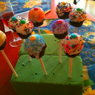 How cute are these 'cake balls on a stick' that my girlfriend lee made?! Balled up cake crumbs put together w cream cheese icing and dipped in choc and white choc candy coating!
