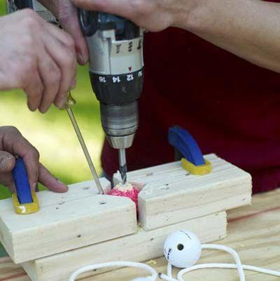 How to Build a Ladder Golf Game Set Drill a hole through each golf ball