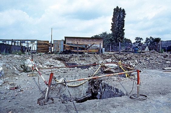 This image shows the demolition of Hitler's bunker. The hole is the stair shaft leading from its western exit.