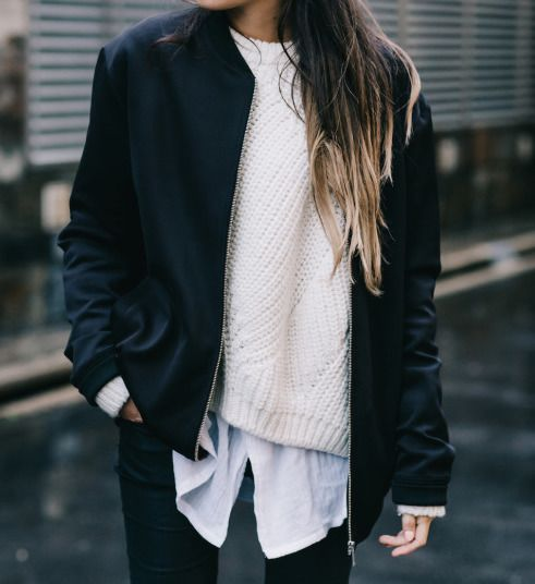 white shirt, white sweater, black navy blue bomber jacket, black pants