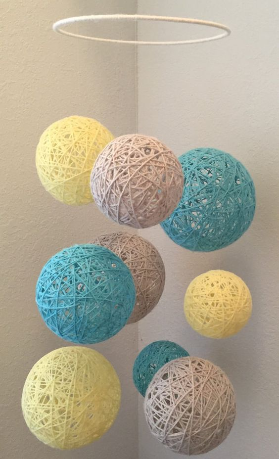 Pale yellow, light gray and aqua yarn ball mobile: