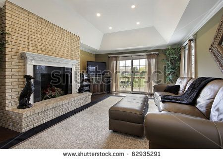 living room, brick fireplace, brown couch, light green walls ...