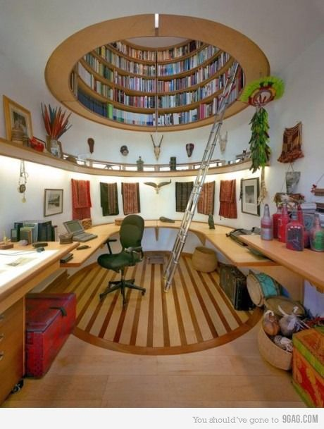 circle bookcase in the ceiling...that's different.