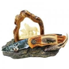 """FX BONE HANDLE LOCKBACK KNIFE      $35.95 USD    This decorative knife is an eclectic, intruiging piece perfect for a den or a desk. The majestic imagery of wolves on a rocky terrain will make observers take notice. Features stainless steel blade with wolf artwork and faux bone handle. Also includes faux bone display stand. Measures 4-1/8"""" closed, 7"""" open. Limited lifetime warranty. Boxed."""