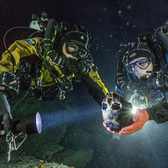 """@paulnicklen on assignment for @Natalie Brewer.  @betonavablank, a National Geographic Grantee and his wife, Susan Bird  carefully observe """"Naia,"""" a 12,000- to 13,000-year-old teenage girl whose remains were found in the Hoyo Negro cave on Mexico's Yucatán Peninsula.  Naia is the oldest, most complete, genetically intact human skeleton discovered in the New World.  These accomplished divers along with Alejandro 'Alex' Alvarez and Franco Attolini made this discovery after exploring countless…"""
