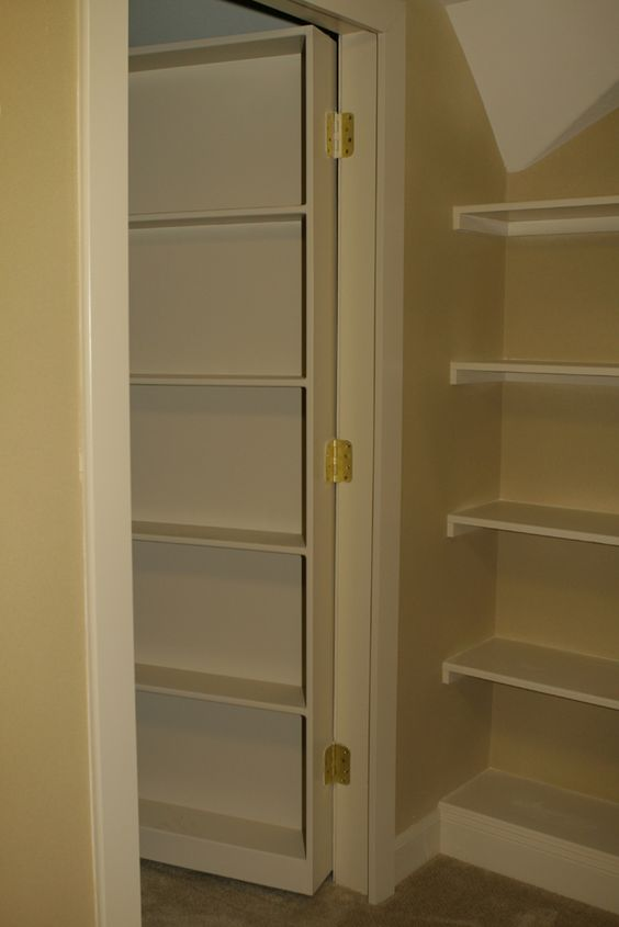 Bookcase Doors This Moving Bookcase Door Swings In To Reveal A Secret Attic Room For The