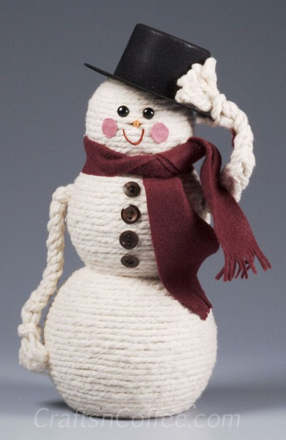 This dapper snowman is handmade with white rope wrapped around styrofoam balls and capped off with a smart top hat!