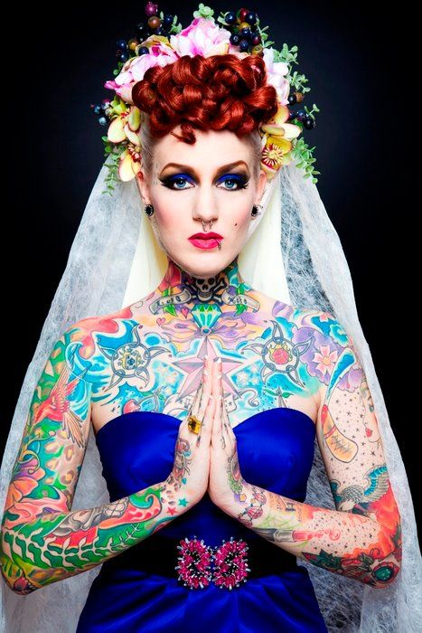 bride with tattoos and bright dress
