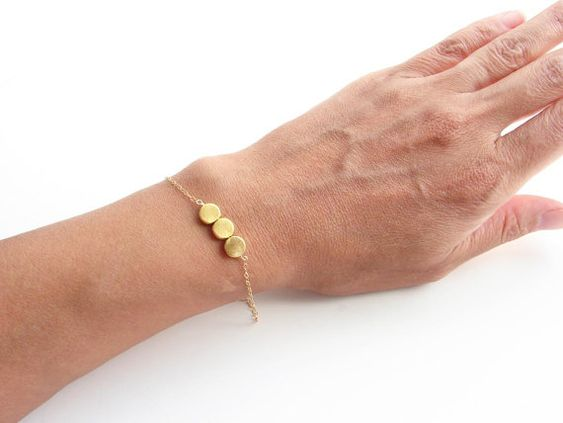 Simple cute and dainty.  It can be worn by itself or layered with my other simple bracelets.    - Three 1/4 gold plated beads  - Delicate 14K gold