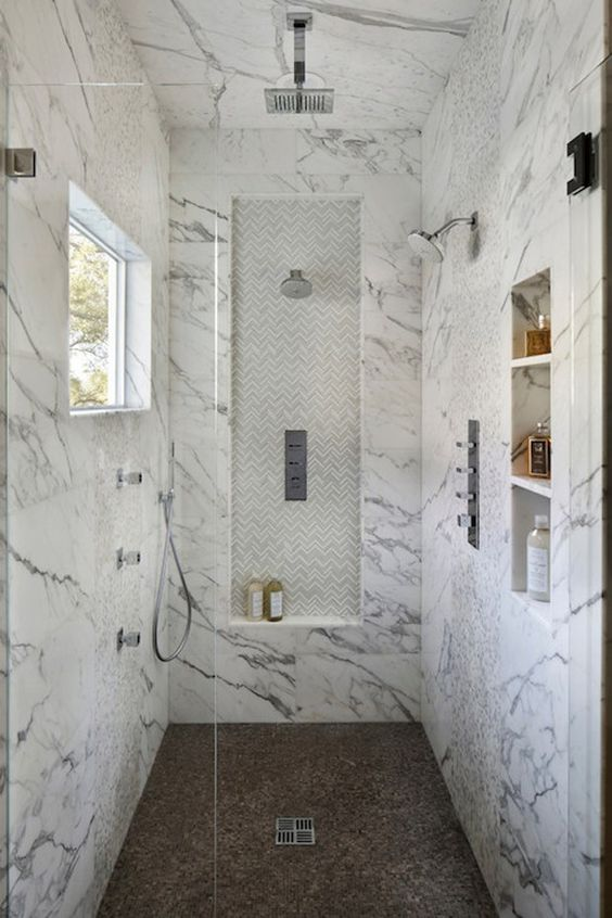THIS is my shower! Love the built ins, love the chevron, that marble is amazing! And who can beat 3 shower heads??