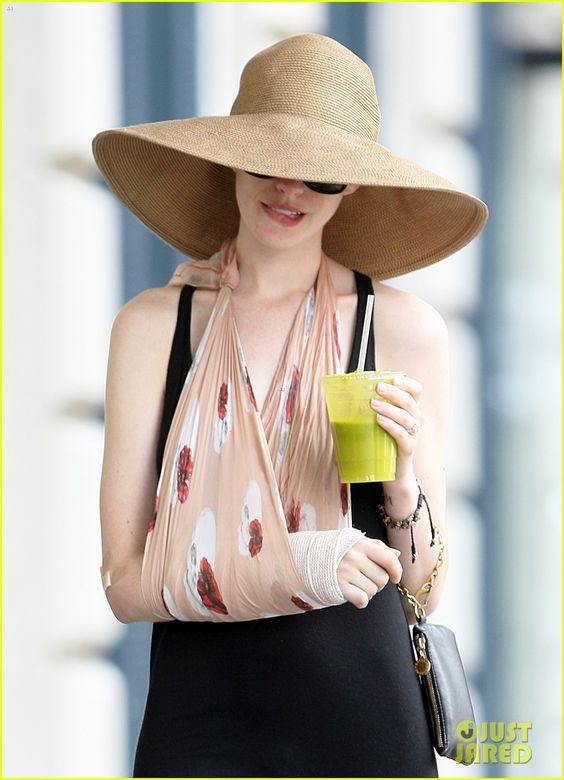 Anne Hathaway: If you are going to rock a broken arm this is 100% the way to do it :)