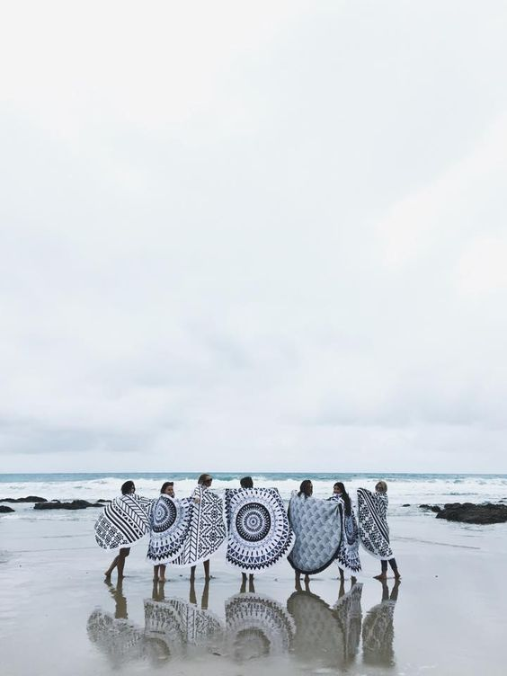 Have I been living under a rock? Why am I just now discovering the brilliant conceptof a round beach towel?! Australian basedThe Beach People launched their brand in 2013 with the Roundie, a cotton fringed towel printedwith boldgraphics. Since then, they've produced other beach ready items