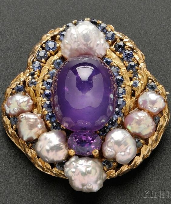 Gorgeous brooch with centered round purple gemstone--pearl accents.