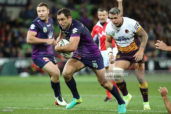 Cameron Smith of the Storm runs in to score a try during the round 25 NRL match…