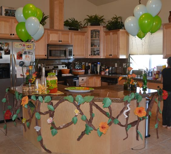 Decorate for jungle theme baby shower. Made vines and leaves from butcher paper! Cheap and easy and really cute!: