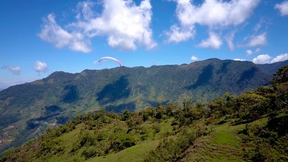 Paragliding over giant waterfalls - Image 18