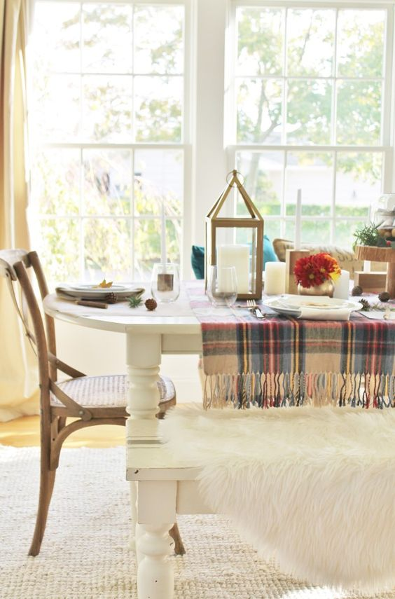 2 plaid scarfs laid horizontally at each end of table as table runners. 6 Ways To Use a Plaid Scarf for fall/winter decorating in your home. CityFarmhouseBlog: