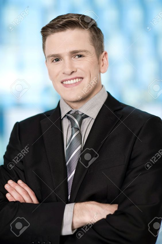 Corporate Guy Posing With Arms Crossed Stock Photo, Picture And Royalty Free Image. Image 24912226.