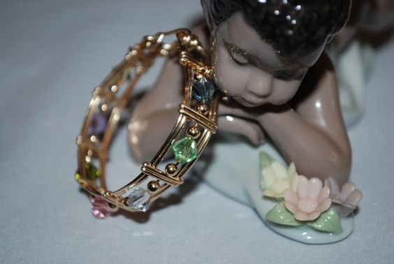 Baby - Infant- Child Goldfilled Wire Wrapped Bangle with Swarovski Crystals. $28.00, via Etsy.