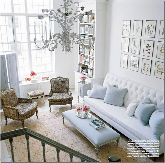 love the chandelier, huge windows, tufted couch, screen....