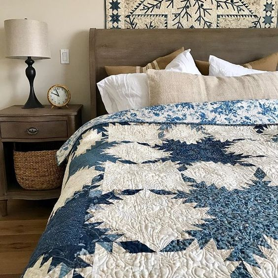 Can't think of a more inviting space in blue and white. #bluebarn #quilting #bedroom #edytasitar #firstflakes #laundrybasketquilts #shiningstar Quilt patterns available at www.laundrybasketquilts.com