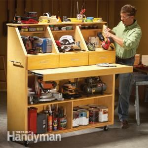 Grab-and-Go Tool Storage, drawers are removable to take to project.  I think I might add some wooden tool boxes on top, perhaps project type specific, plumbing tools, electrical tools.  The pull out work service would could encourage me, to put my tools away are retract the surface in between projects....