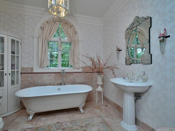 Clawfoot tub, pedestal sink, and romantic light and window treatment in this bathroom. Wall, NJ