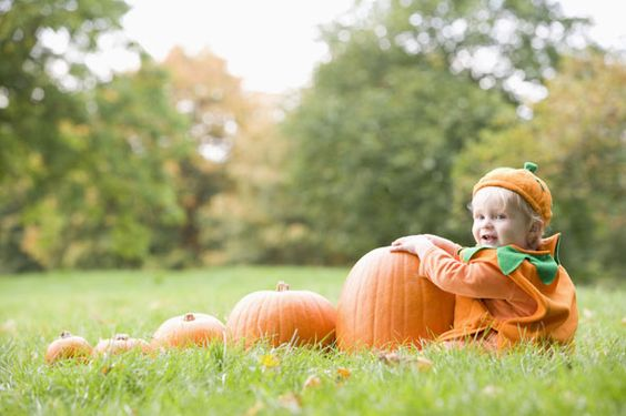 Pumpkin patches make a great backdrop for Fall family photos.