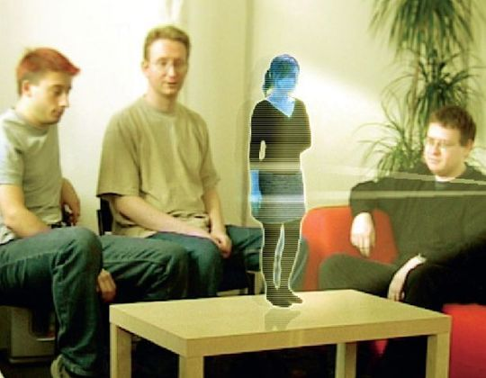 A picture of a possible use for holograms, when a person wants to speak with you face to face, they can through their image being projected in full 3-D in real time so that they can speak with you.