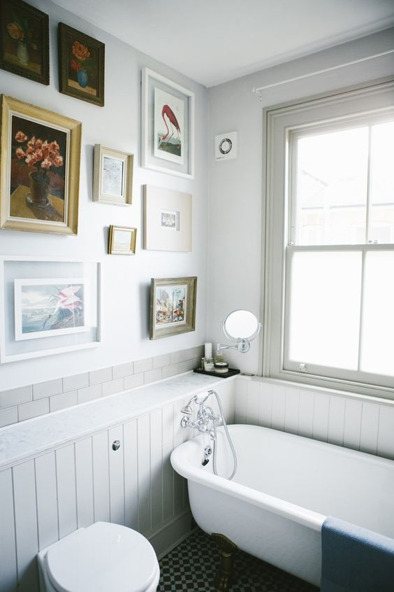 Tongue and groove paneling and claw foot tub in bathroom of Victorian house renovation by Imperfect Interiors, Beth Dadswell, London, Photography by Leanne Dixon | Remodelista