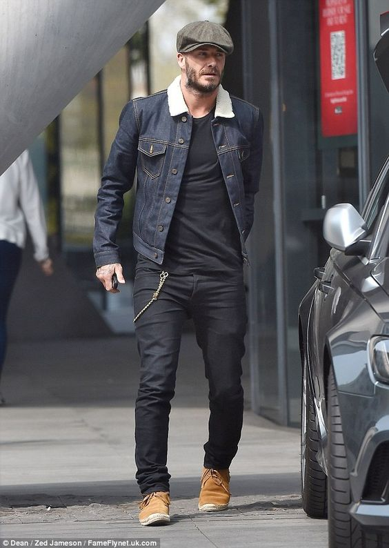 Still handsome: David Beckham worked a somewhat granddad-inspired look with his flat cap a...