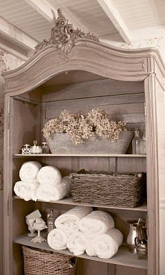 I want to try for this look with an old tall tv entertainment/armoire. It seems you could gut it out and remove drawers and tv shelf and build shelves than paint and distress: