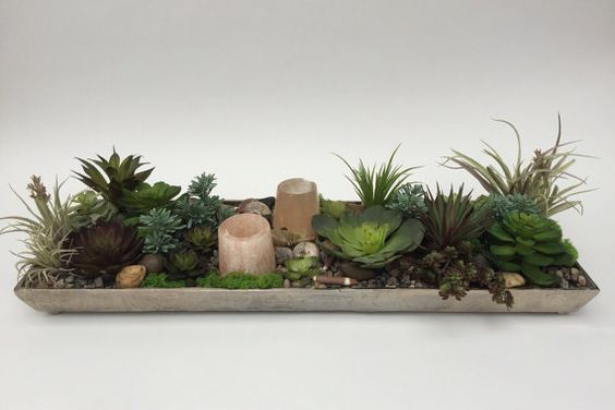 Succulent garden tealight holder.